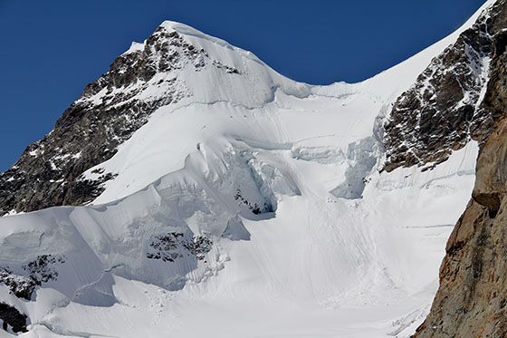 Climbers going up the Jungfrau   The human silhouettes provide a sense of the scale