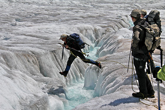 Werner Fischer jumping across the stream   Jumping is the way to cross it   like we did it for several crevasses