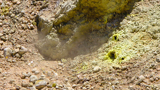 Fumaroles constantly hissing   Sulfur crystal holes pouring out steam and sulfur gas