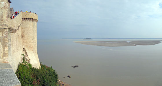 Rising tide around the Mont Saint Michel   The distant sandy island was drowned by the rising water in no time