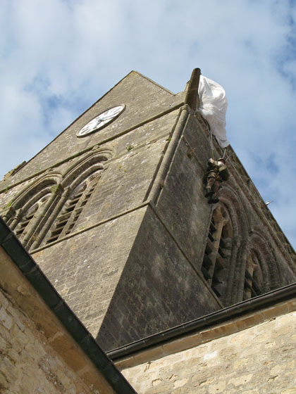 The parachute of paratrooper John Steele was caught on the church's roof