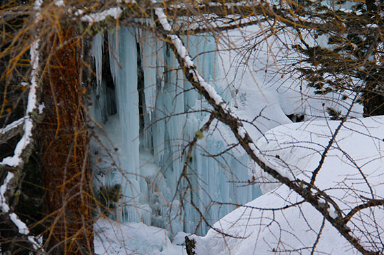 Frozen cascade near the tiny village Zmutt