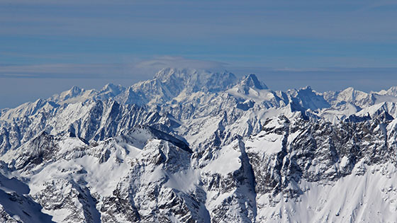 Mount Blanc hidden in the clouds   The Grandes Jorasses are the black mouton seen on its right   right behind the D�me du V�lan   this beautiful white and smooth glacier, perched on top of Mont V�lan.